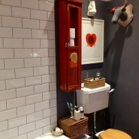 An old gas workers cupboard becomes a great loo roll store!.